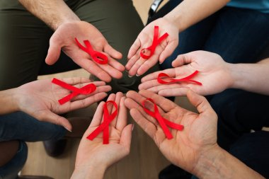 People Holding Aids Ribbons