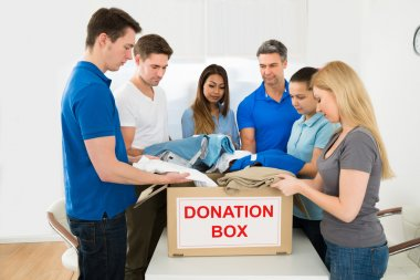 Volunteers Holding Clothes