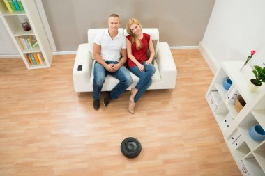 Couple With Robotic Vacuum Cleaner