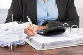 Businessperson Calculating Bills