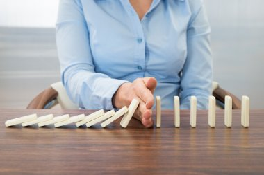 Businesswoman Stopping Effect Of Domino