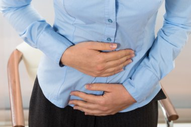 Businesswoman Suffering Stomachache