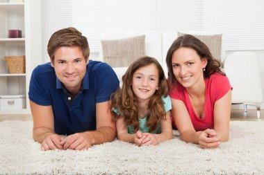 Family Lying On Rug