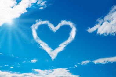 Low angle view of heart shaped cloud in blue sky stock vector