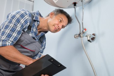 Male Plumber With Clipboard