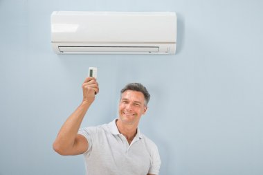 Man Using Air Conditioner