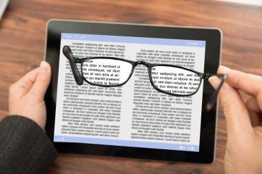 Person Reading E-book