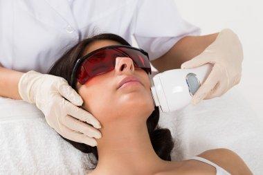 Beautician Giving Epilation Laser Treatment