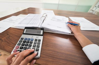 Businessperson Hands Calculating Bill