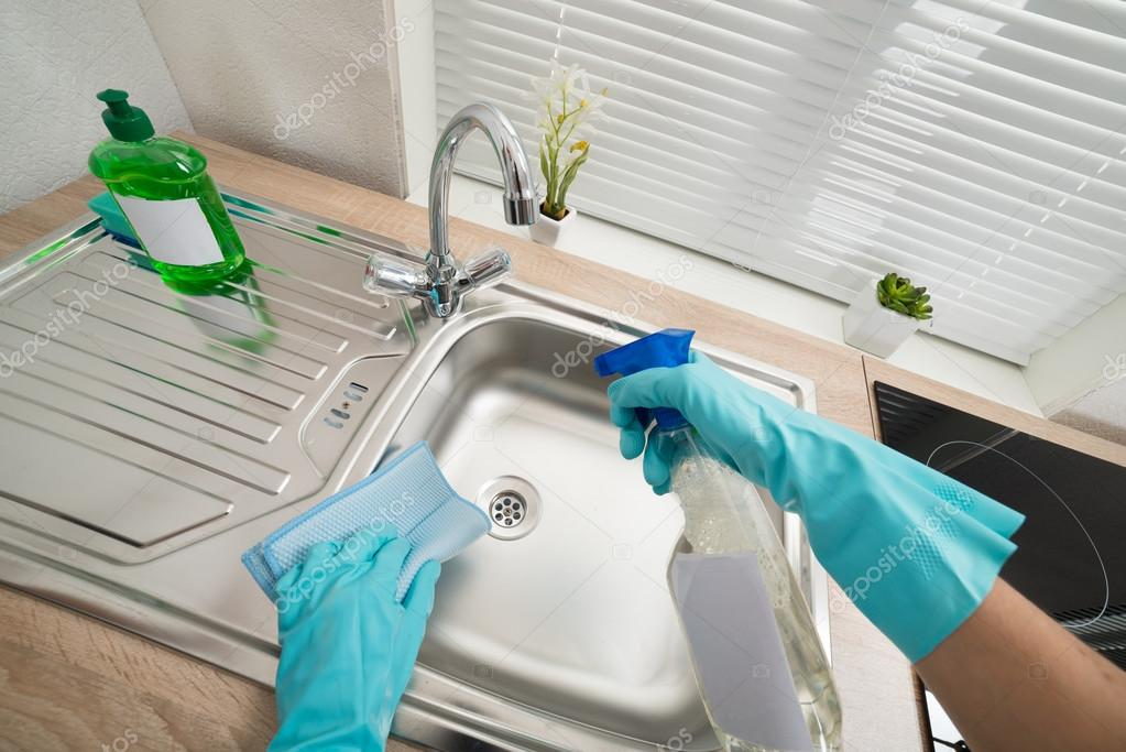 Hands Cleaning Kitchen Sink — Stock Photo © AndreyPopov #72571317