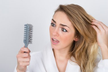 Woman Looking At Comb