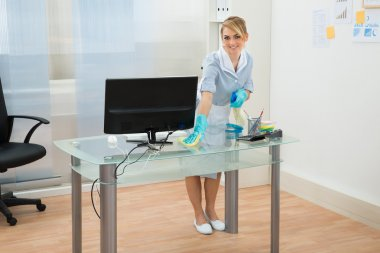 Maid In Uniform Cleaning Desk