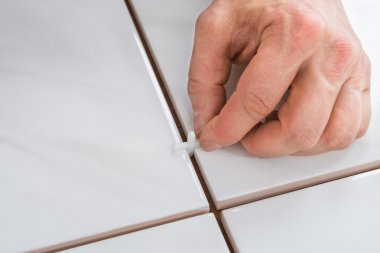 Hand Placing Spacers Between Tiles
