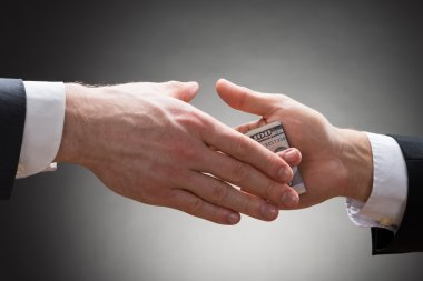 Businessman's Hand Giving Bribe