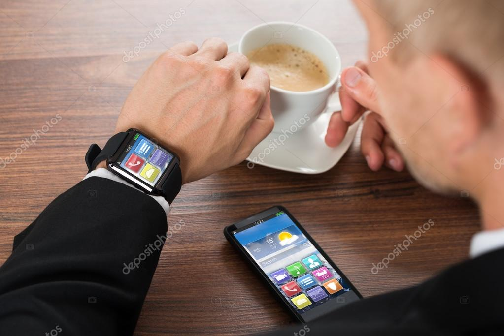 Businessman With Smartphone And Smart watch