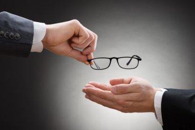Businessman Giving Eye Glasses