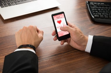 Businessman Cellphone Showing Heart Rate