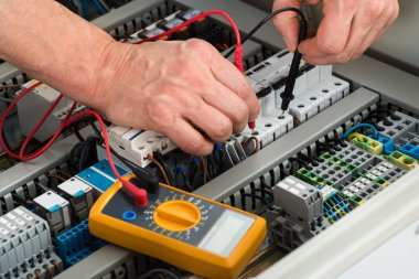 Male Electrician Checking Fuse