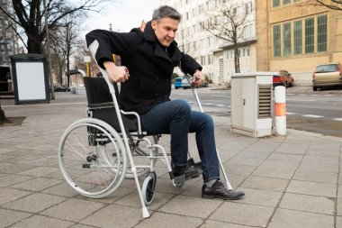Disabled Man Trying To Walk