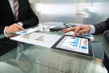 Businessmen Working On Digital Tablets