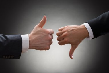 Businesspeople Hands Showing Thumbs