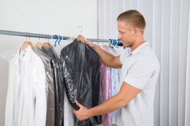 Man In Dry Cleaning Store