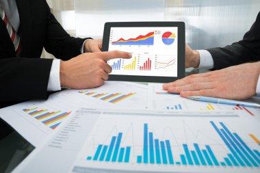 Businessmen Discussing Graph