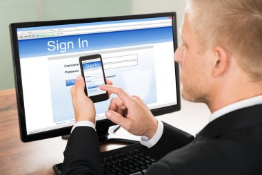 Businessman Signing In Email Account