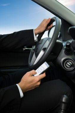 Man with Cellphone While Driving Car