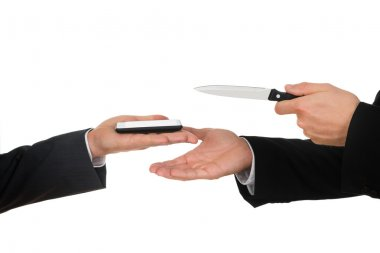 Businessman Hand Showing Knife