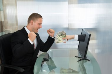 Excited Businessman With Money