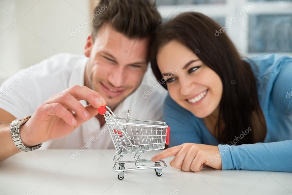 Couple Looking At Shopping Cart