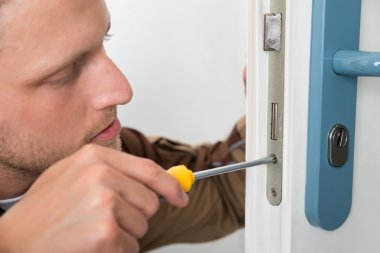 Carpenter Repairing Door Lock