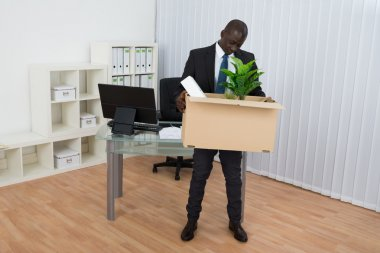 Businessman Holding Cardboard Box