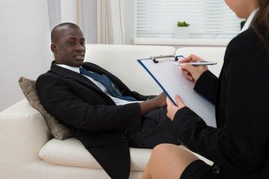 Psychiatrist Making Notes