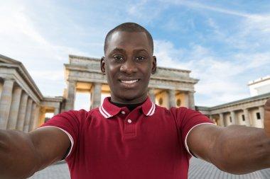 Man and Brandenburg Gate