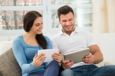 Couple Using Digital Tablets