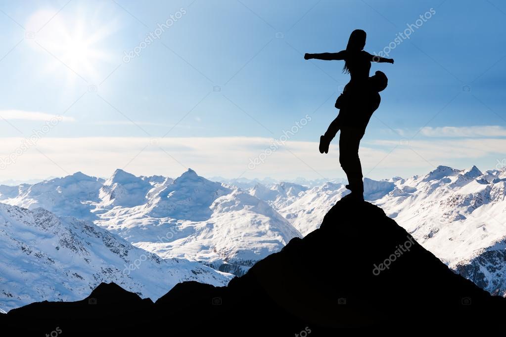 Couple On Top Of Snow Mountain