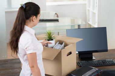 Businesswoman Packing Belongings