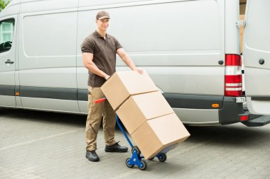 Delivery Man Holding Trolley