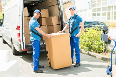 workers Loading Boxes In Truck