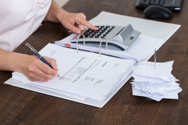 Accountant Calculating Receipt