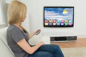 Photo Woman Holding Remote Control