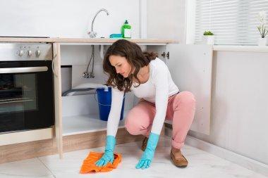 Woman Wiping Floor