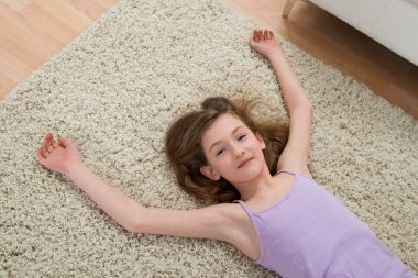 Girl Resting On Carpet After Workout
