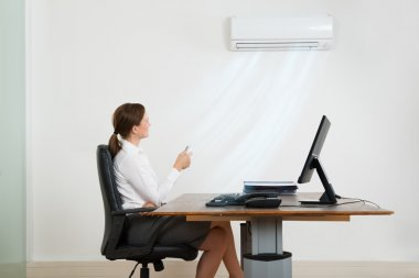 Businesswoman Using Air Conditioner