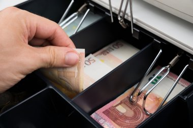 Hands With Banknotes In Cash Register