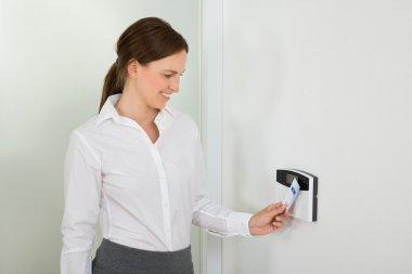 Businesswoman Inserting Keycard