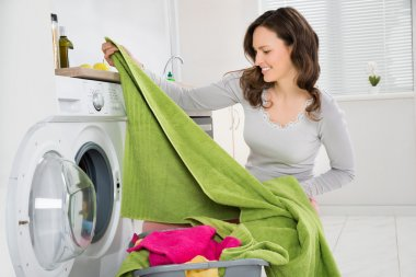 Woman Laundering Clothes