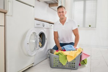 Man On Floor And Putting Towels